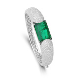 A REGAL EMERALD AND DIAMOND BANGLE -    - Auction of Fine Jewels & Watches