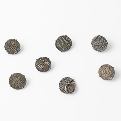 A SET OF SIX SILVER BUTTONS
