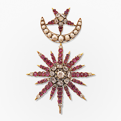 AN EXCEPTIONAL RUBY AND DIAMOND BROOCH