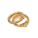 A PAIR OF DIAMOND AND GOLD BANGLES -    - Spring Auction of Fine Jewels