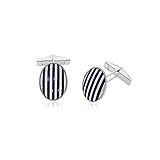 A PAIR OF GOLD AND ENAMEL CUFFLINKS -    - Auction of Fine Jewels & Watches