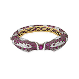 A CONTEMPORARY RUBY AND DIAMOND `KADA` BANGLE -    - Auction of Fine Jewels & Watches