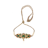 AN EMERALD, RUBY AND DIAMOND `BAZUBAND` ARM ORNAMENT -    - Auction of Fine Jewels & Watches