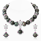 AN IMPRESSIVE SUITE OF TAHITIAN PEARL, RUBY AND DIAMOND JEWELRY -    - Auction of Fine Jewels & Watches