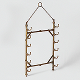 A BRASS CAMPAIGN TOWEL PEG -    - Travel and Leisure Auction