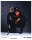 A SIGNED PHOTOGRAPH OF TIGER WOODS -    - Travel and Leisure Auction