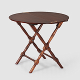 A CIRCULAR FOLDING CAMPAIGN TABLE -    - Travel and Leisure Auction