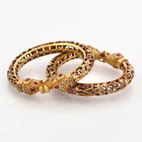 -A PAIR OF RUBY AND PEARL 'KADA' BANGLES