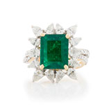 -A COLOMBIAN EMERALD AND DIAMOND RING