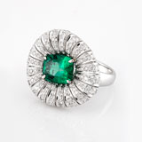-AN EMERALD AND DIAMOND RING